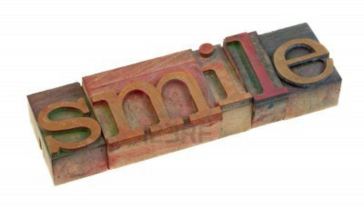 7398182-the-smile-word-in-vintage-wooden-letterpress-type-blocks-stained-by-color-ink-isolated-on-white.jpg