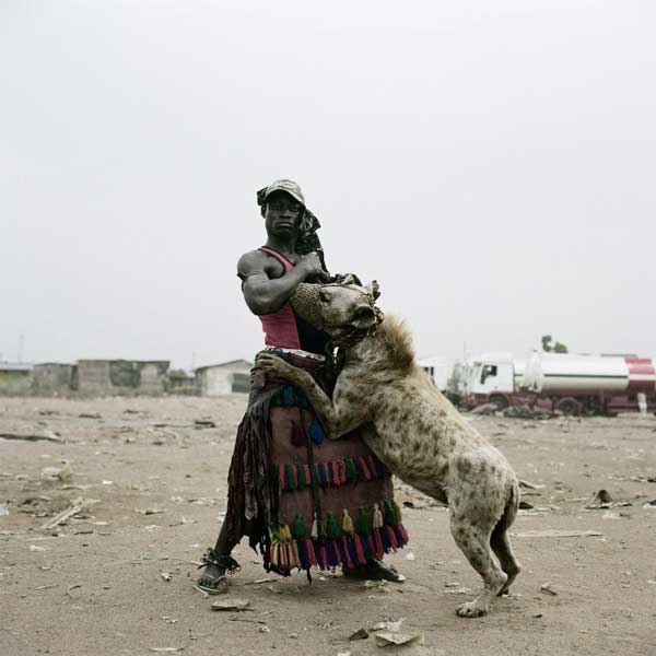A man with a pet hyena, Nigeria Funny Animal Picture