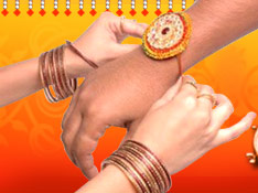 A Sister bind the Rakhi on Brothers Hand