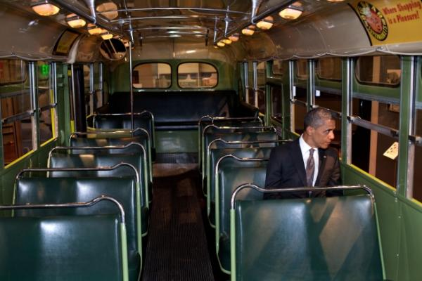 Obama sitting on the bus Funny Men Image